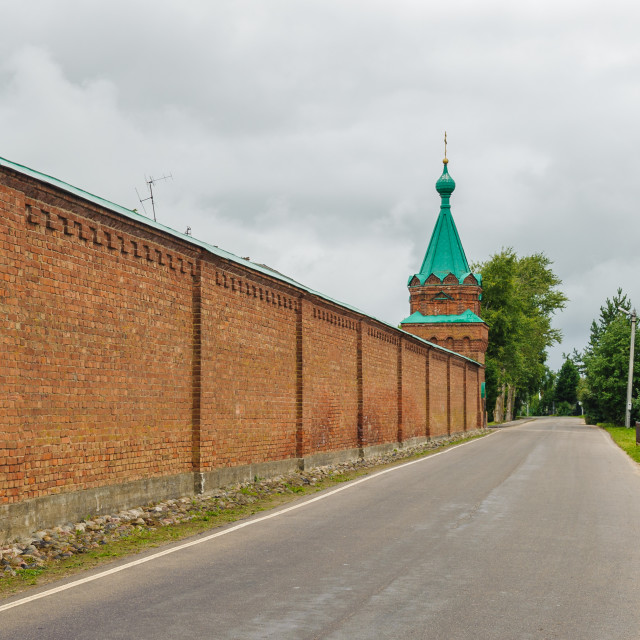 """""""Red wall surrounding the Orthodox monastery in Old Ladoga town, Russia"""" stock image"""