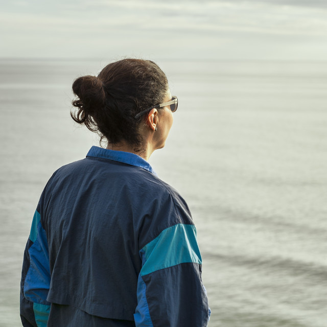 """""""Solitary adult woman ocean view"""" stock image"""