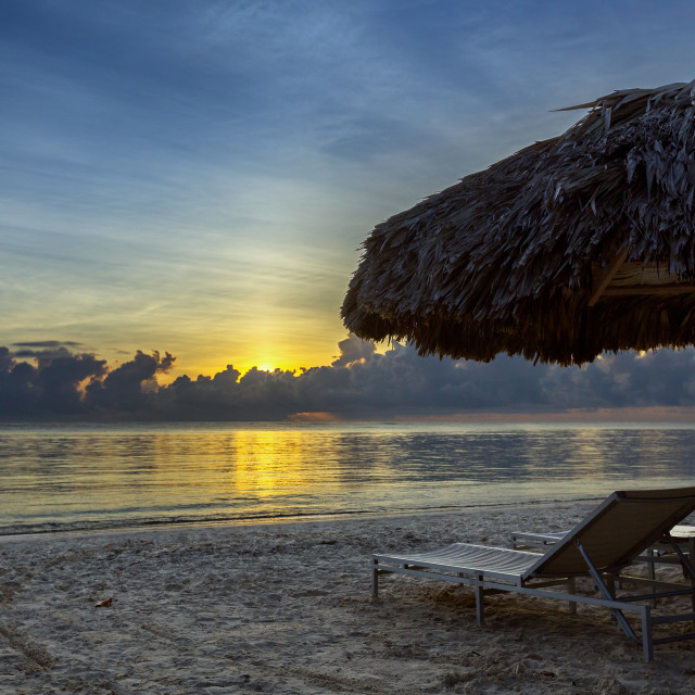 """Sunbeds on the beach at sunrise"" stock image"