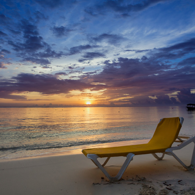 """Sunbed on the beach at sunrise"" stock image"