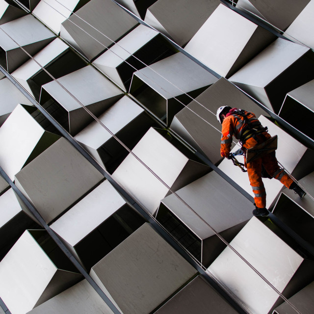 """""""Rope Access Worker on geometric"""" stock image"""