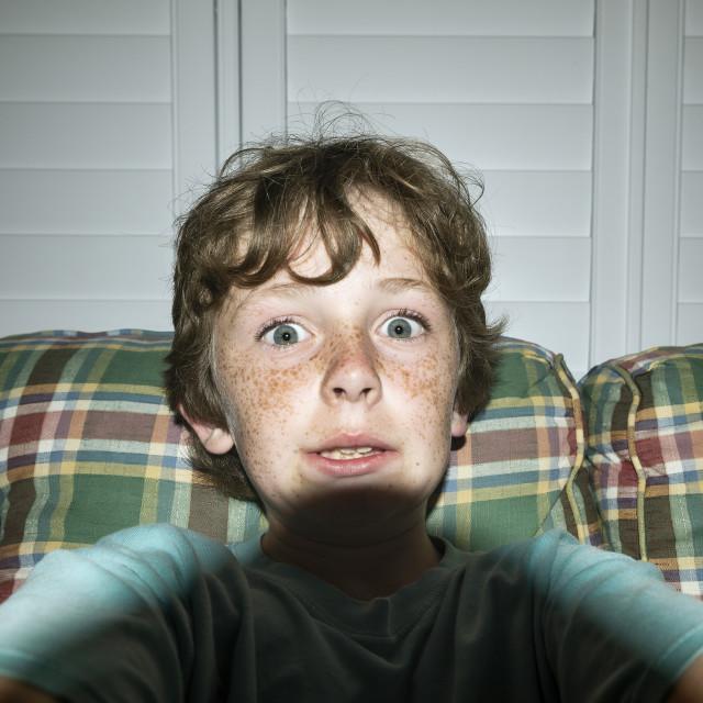 """Boy taking a humorous selfie"" stock image"