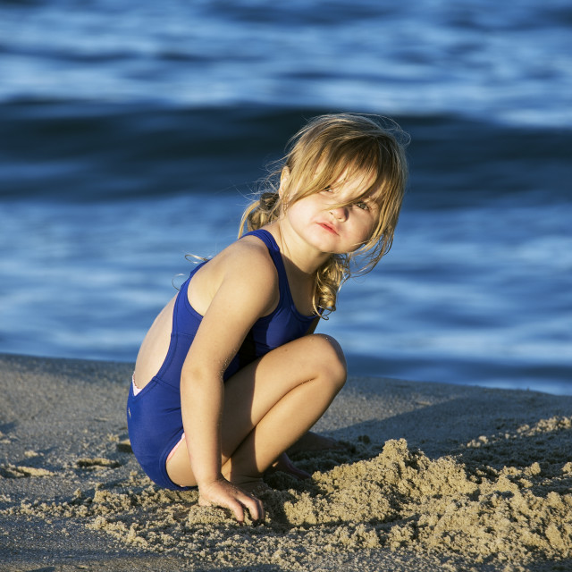 """""""Girl plays at the beach"""" stock image"""