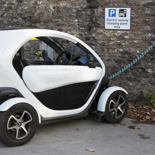 """Electric vehicle and charging point."" stock image"