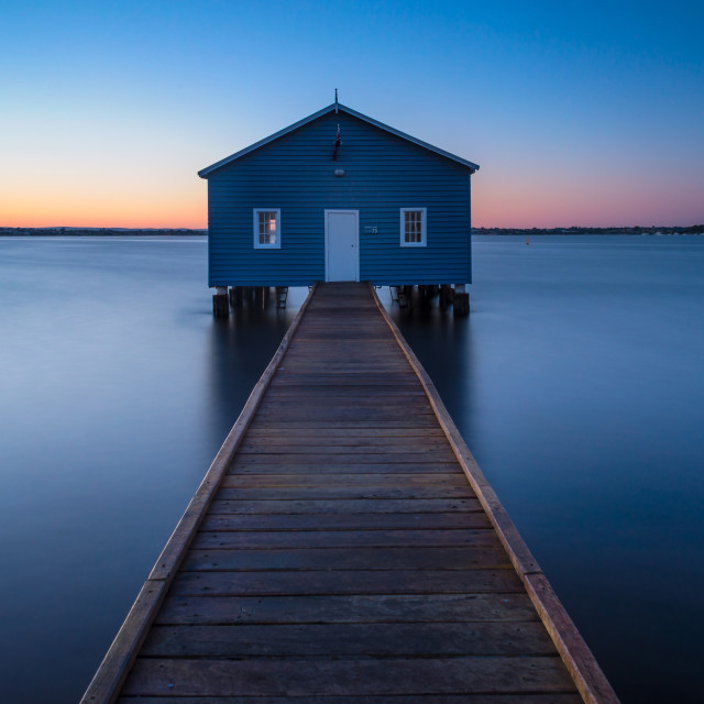 """Sunrise at a boat shed"" stock image"