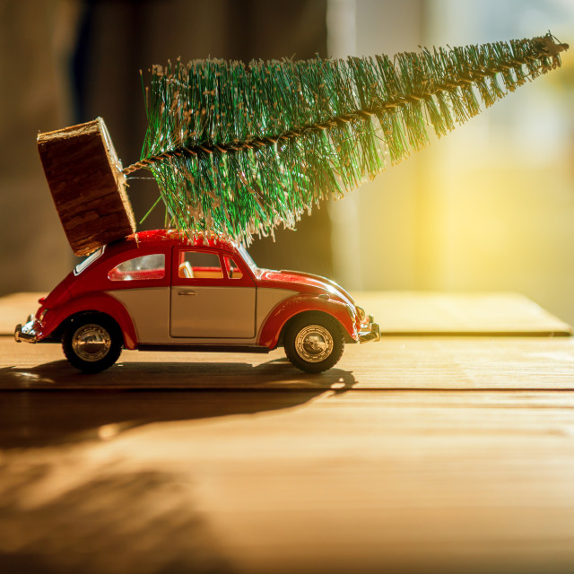 """Retro toy car carrying tiny Christmas tree"" stock image"