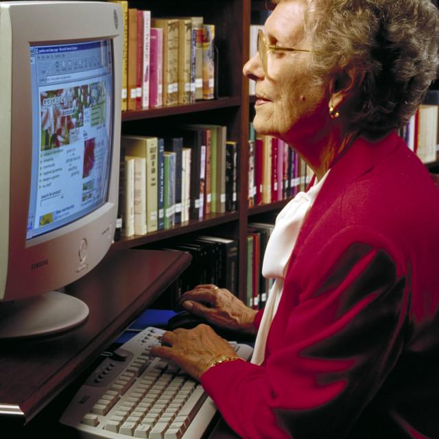 """Senior woman using the internet."" stock image"