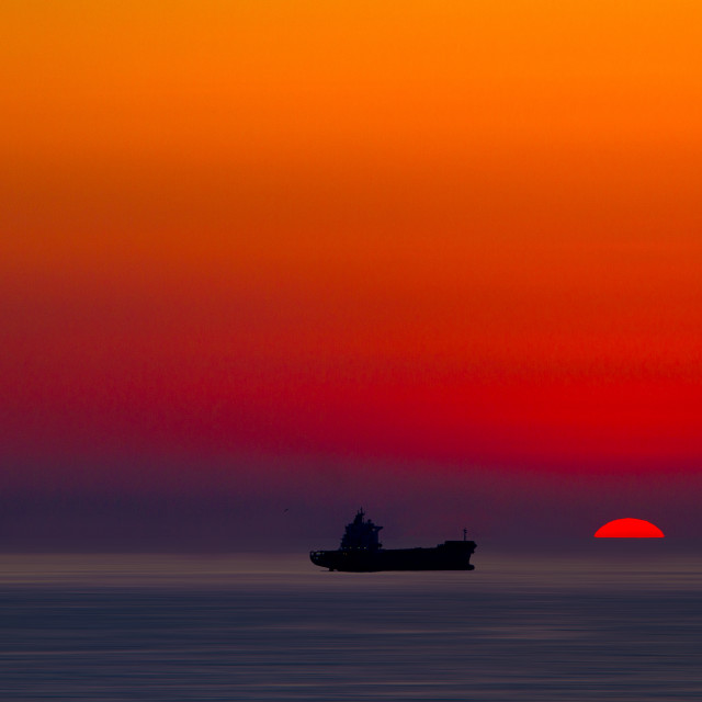 """Sunset over the mediterranean sea with ship"" stock image"