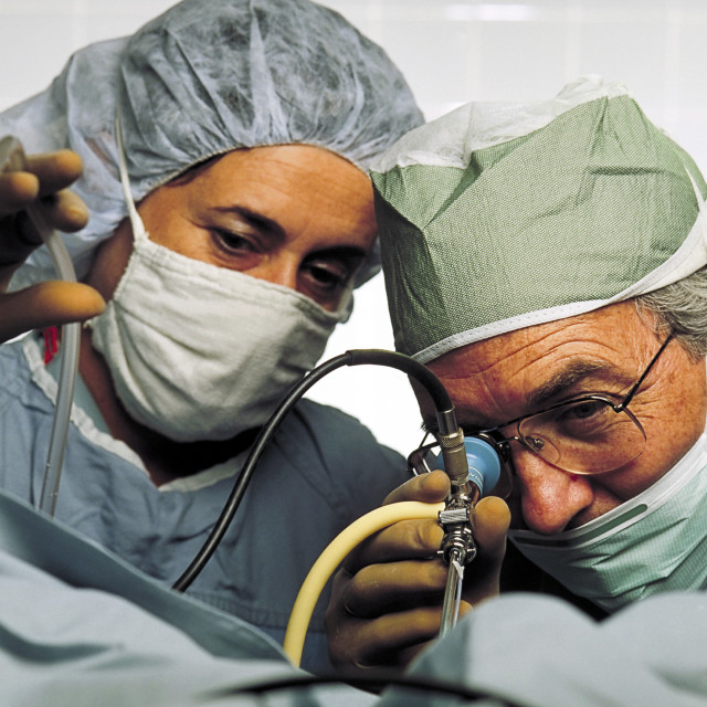 """Obstetrician gynecologist surgeon conducts endoscopic surgery."" stock image"