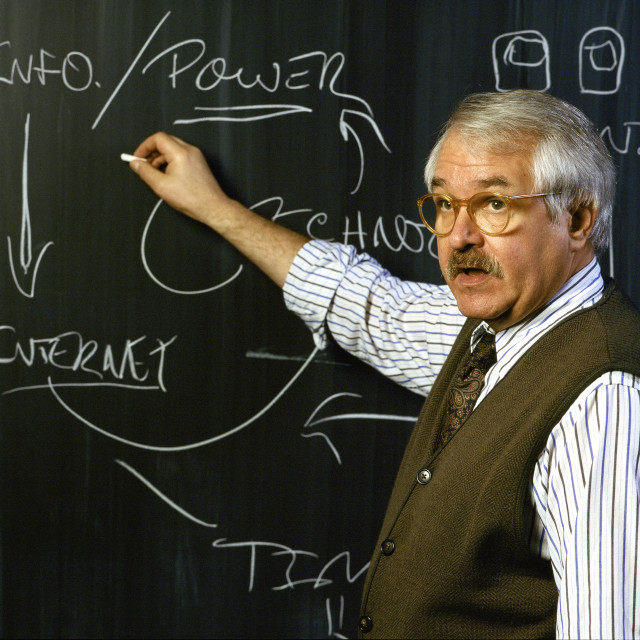 """""""College professor teaching a course about the internet."""" stock image"""