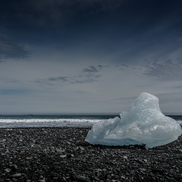 """Iceberg on Black Sand Beach"" stock image"