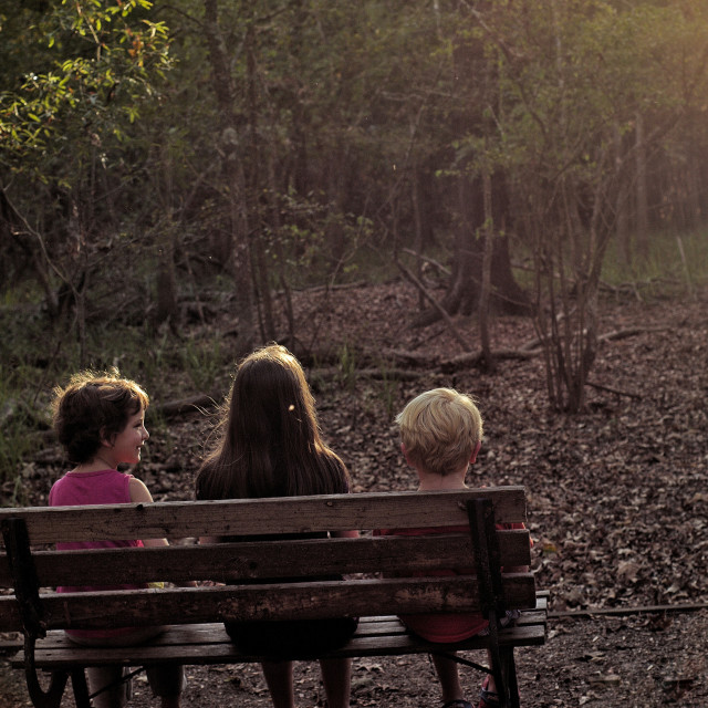 """Children on a park bench"" stock image"