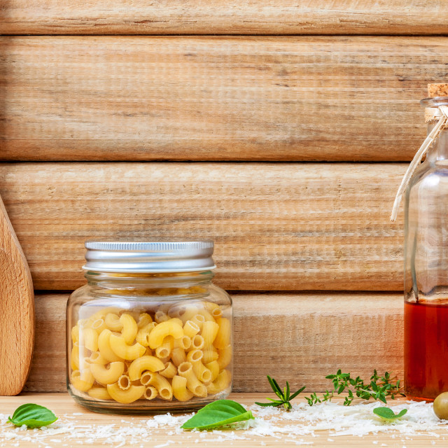 """""""Italian food concept dried pasta with vegetables ,olive oil and spices herbs..."""" stock image"""