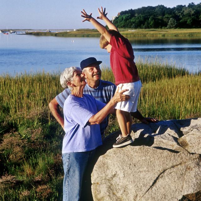 """Grandparent are ejjoying their grandson."" stock image"