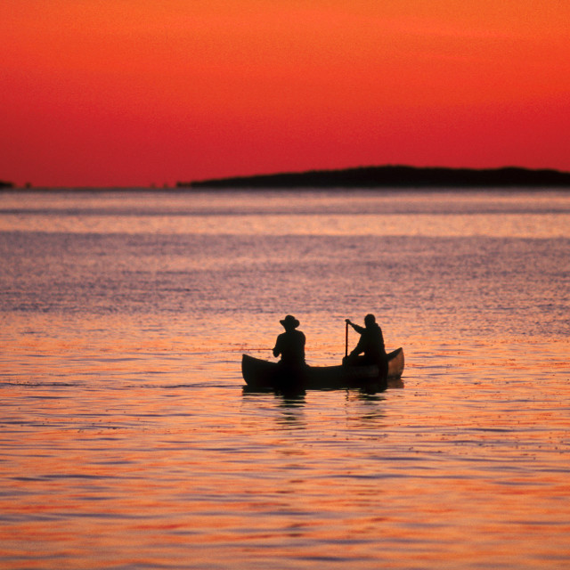 """Fishing from a canoe, Martha's Vineyard,"" stock image"