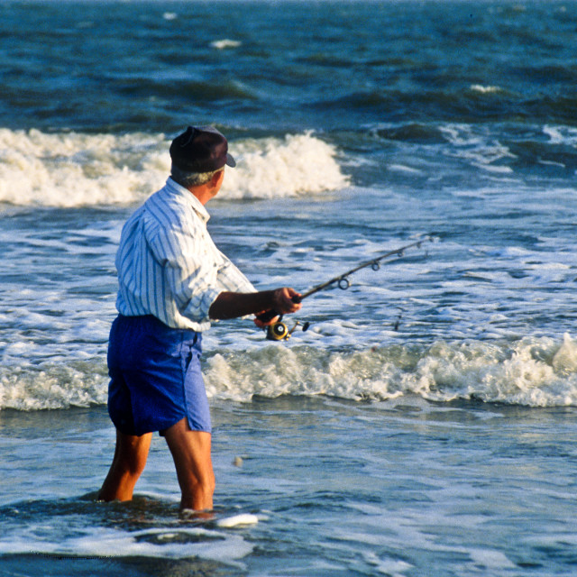 """Senior man surf fishing."" stock image"