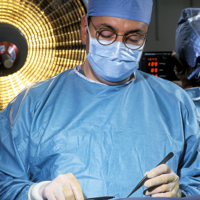 """Surgeon performs an operation."" stock image"