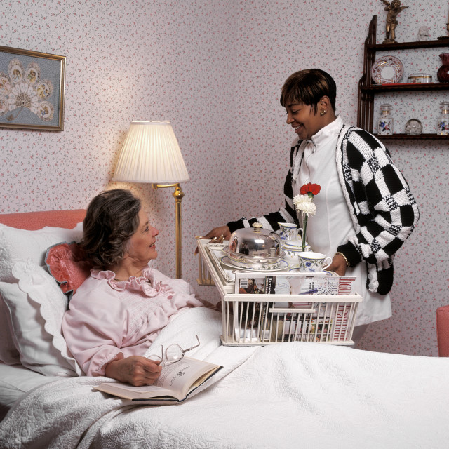"""""""Nurse visiting a patient in his home. Home healthcare."""" stock image"""