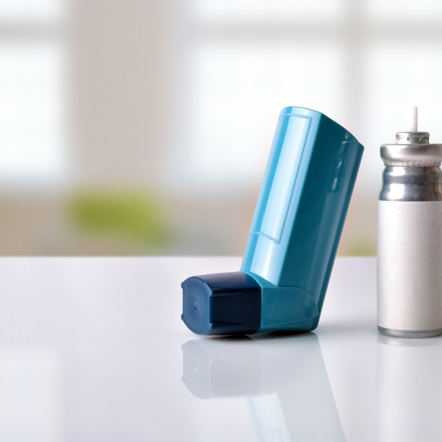 """""""Cartridge and blue medicine inhaler in a room front view"""" stock image"""
