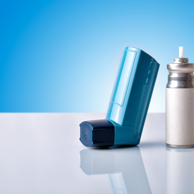 """""""Cartridge and blue medicine inhaler with blue background front view"""" stock image"""