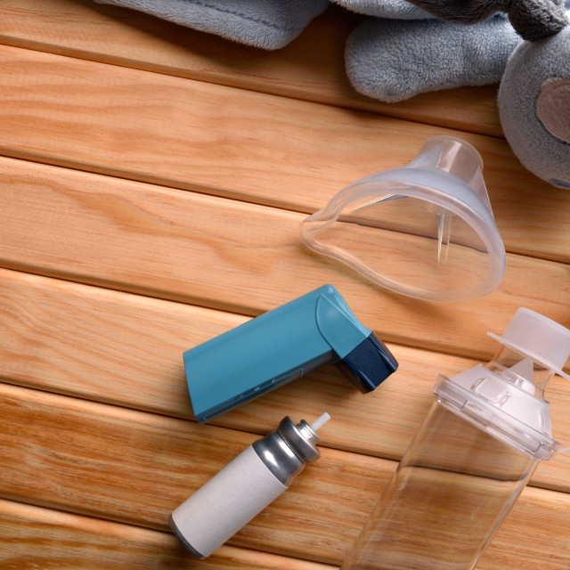 """""""Cartridge inhaler and chamber and mask parts pediatric on wood"""" stock image"""