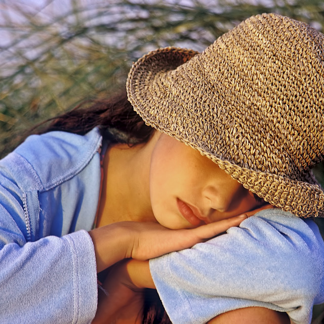 """""""Young girl resting at the beach."""" stock image"""