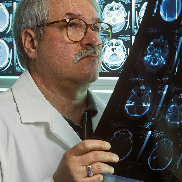 """Docter reviews patient MRI."" stock image"