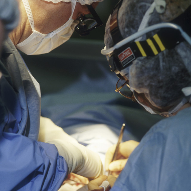 """Surgeons performing a surgical procedure."" stock image"