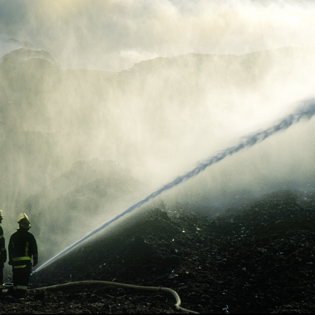 """Fire fighters with hose."" stock image"