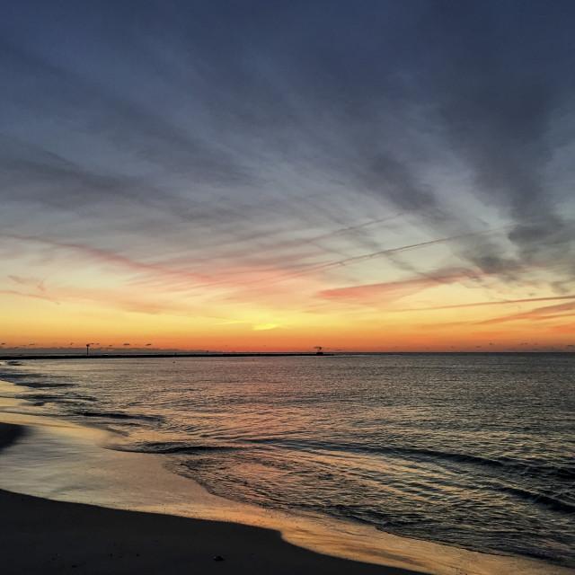 """A Beach Sunrise"" stock image"