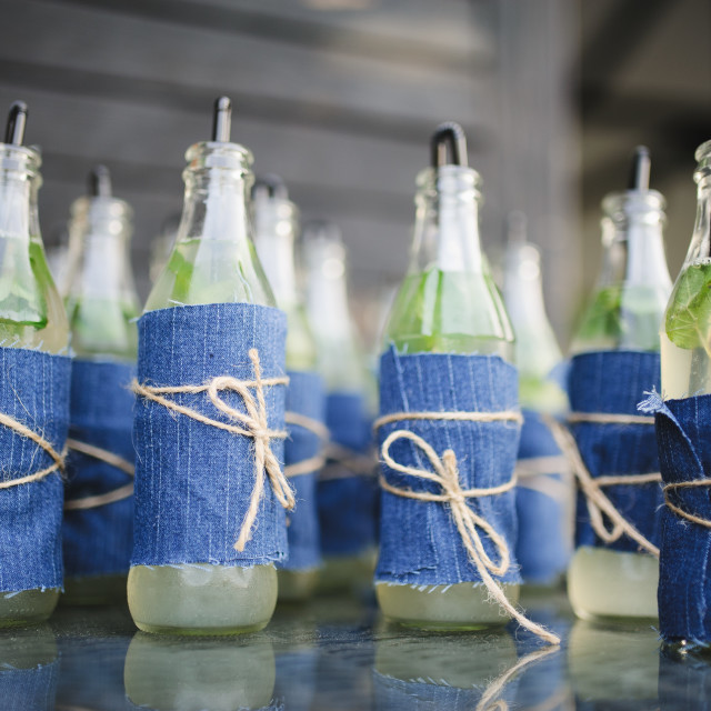 """""""drink bottles boho style at a wedding reception party"""" stock image"""