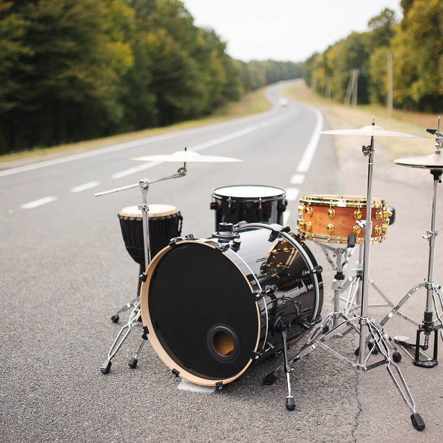 """Drum Set on the road summer time"" stock image"
