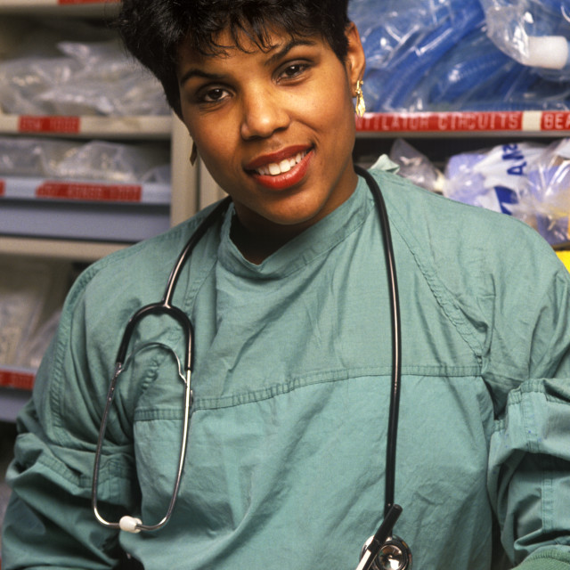 """Portrait of a nurse at at nurses station"" stock image"