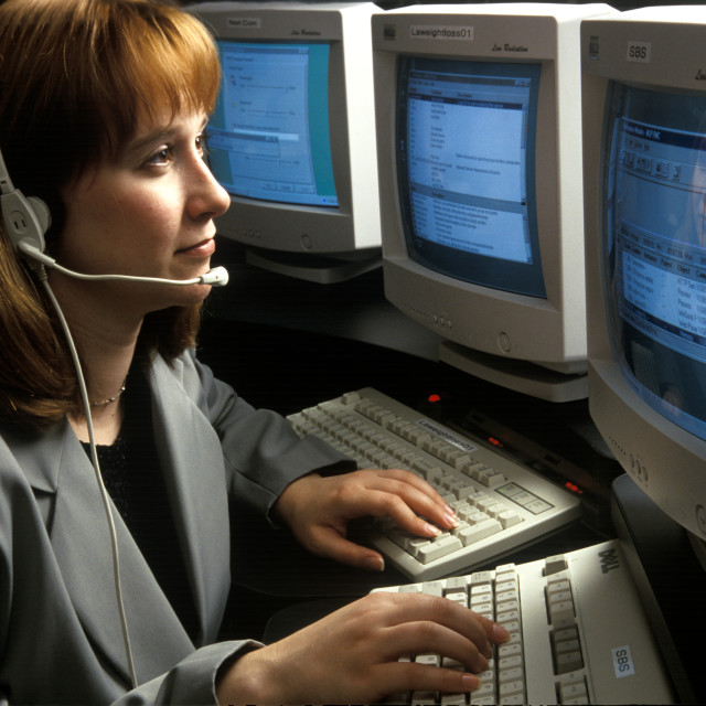 """Woman telephone operator or customer service representative."" stock image"