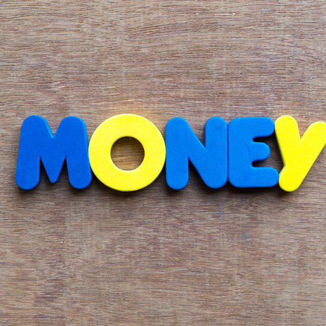 """money word in wood background"" stock image"