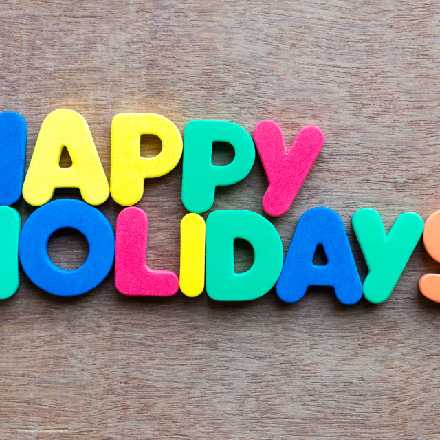 """happy holidays words in wood background"" stock image"