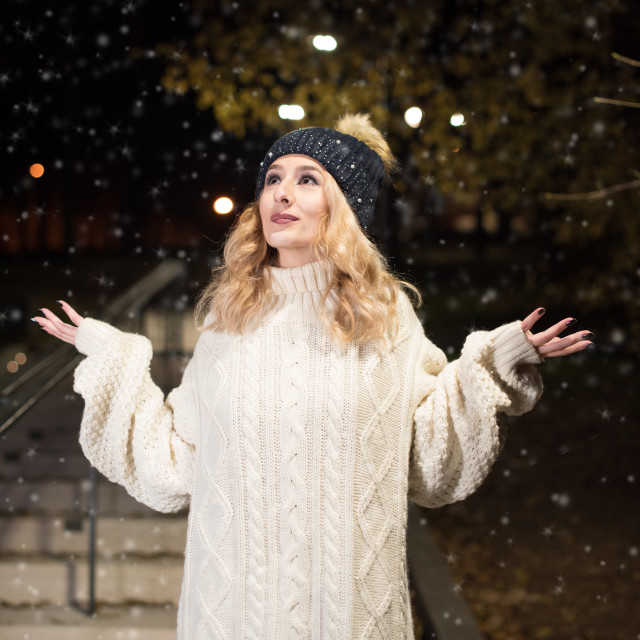 """girl in park looking at snow"" stock image"