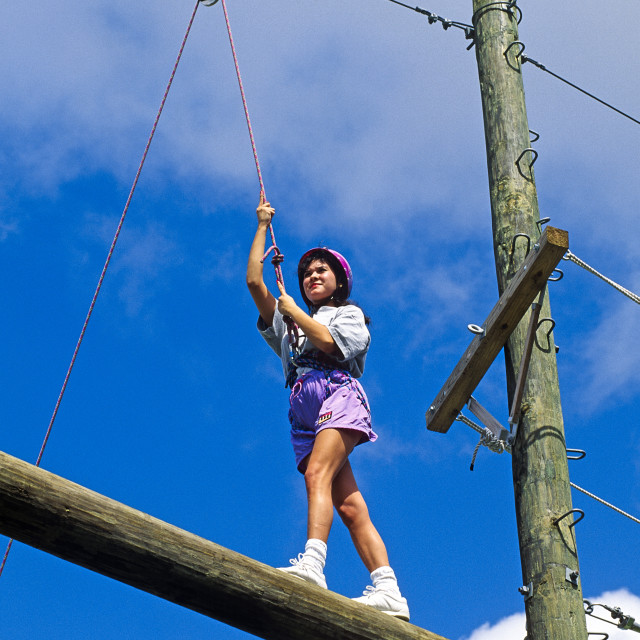 """""""Woman on a confidence course station."""" stock image"""