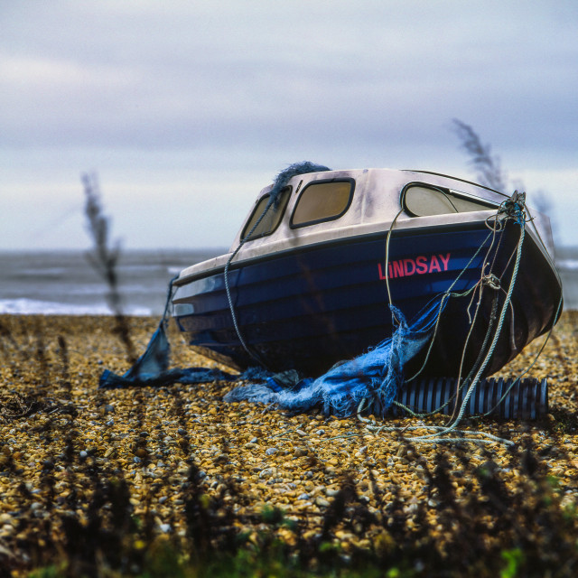 """Abandoned boat on the beach"" stock image"
