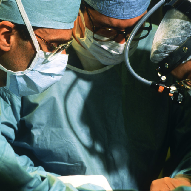 """Surgeons performing a surgical procedure"" stock image"