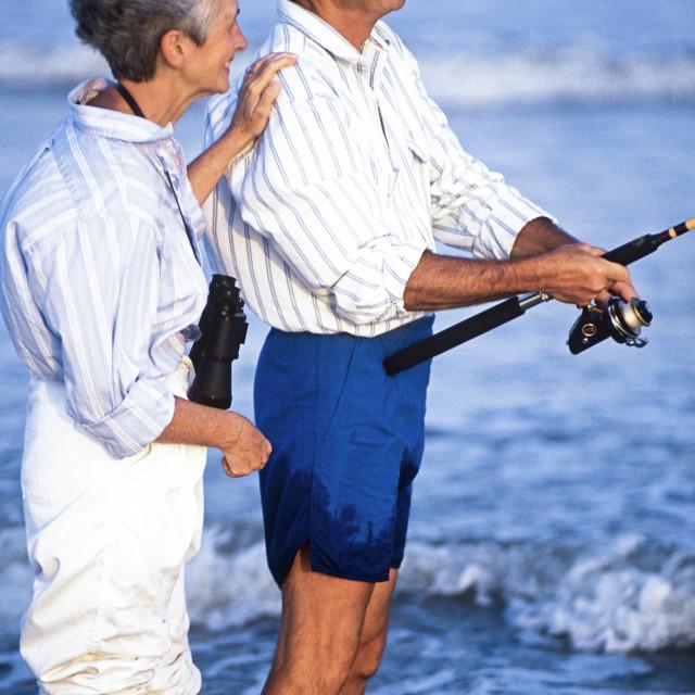 """Senior couple spending time together surf fishing, Outer Banks, North Carolina, NC"" stock image"