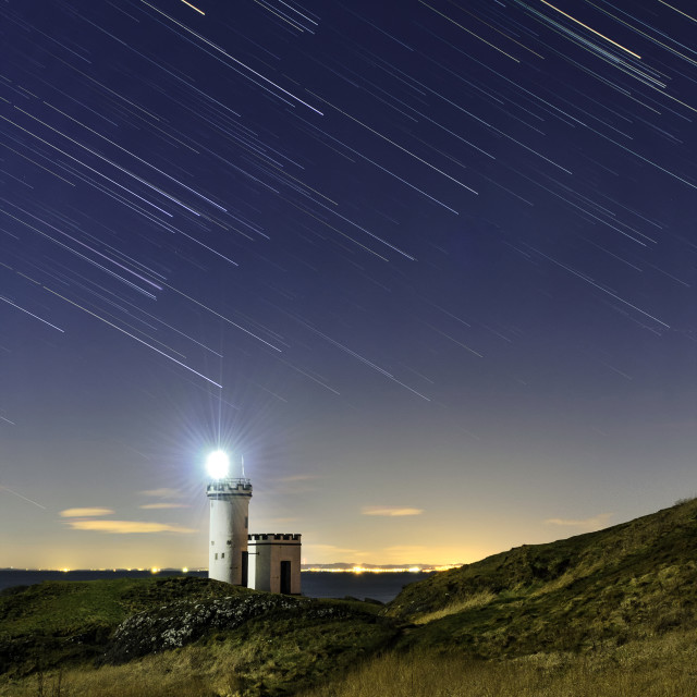 """""""Ellie Lighthouse with Star Trails"""" stock image"""
