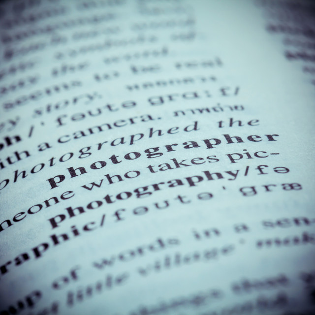 """""""Close up of old English dictionary page with word Photographer. Shallow depth..."""" stock image"""