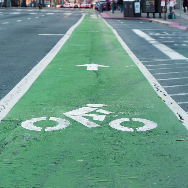"""Bike lane painted in green"" stock image"