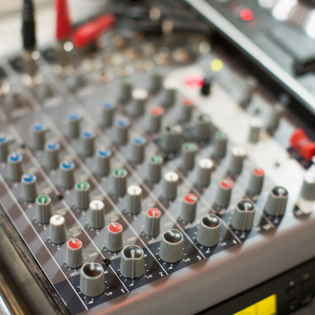 """Professional audio mixing console"" stock image"