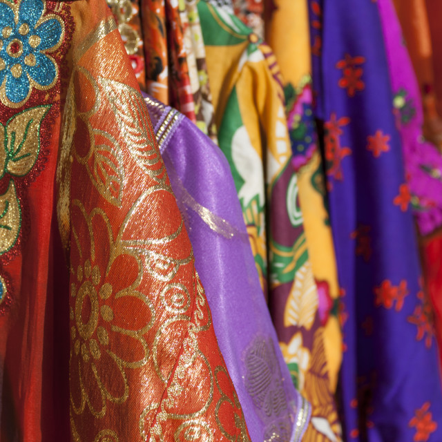 """Colourful dresses in the shop"" stock image"