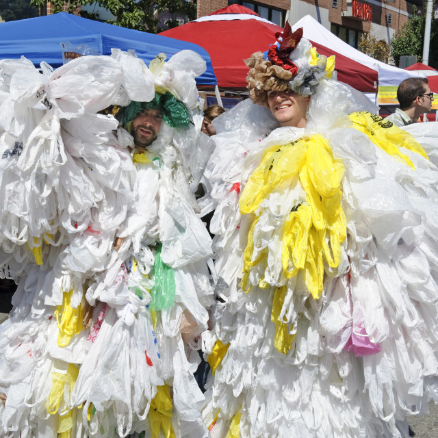 """Men dressed in plastic shopping bags to illustrate the excessive waste, consumption, and harm to our environment. GreenFest Philly 2008 event, Philadelphia, Pennsylvania"" stock image"