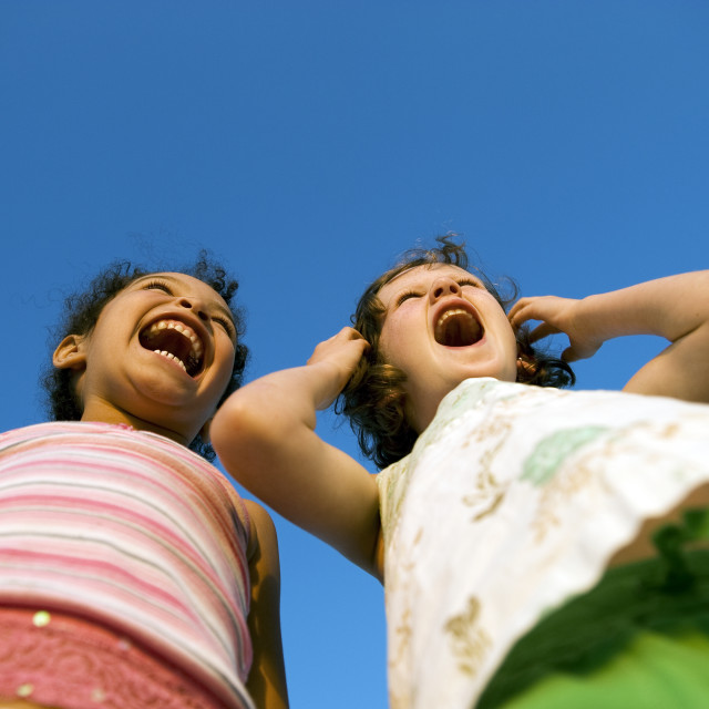 """""""Girlfriends yelling in delight."""" stock image"""