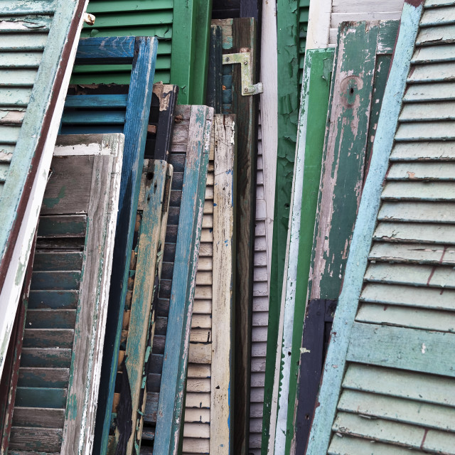 """Reclaimed shutters and doors at a salvage yard."" stock image"