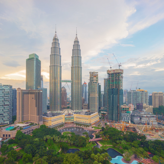 """The golden sunset view of Petronas Twin Towers during blue hour in Kuala Lumpur."" stock image"